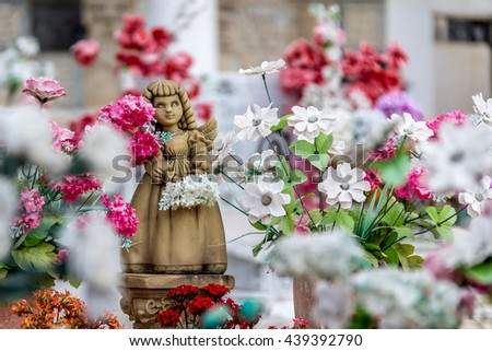 Cute angel girl statue and flowers