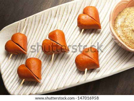 Cute appetizers. Sausages with mustard. - stock photo