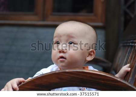 Cute asian baby boy in park - stock photo