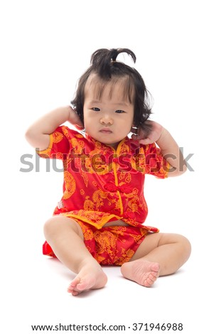 Cute Asian baby girl in traditional Chinese suit Isolated on white background, Chinese New Year Concept
