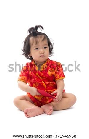 Cute Asian baby girl in traditional Chinese suit with red pocket, Isolated on white background, Chinese New Year Concept