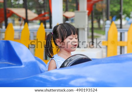 Cute asian baby play in toy car, play ground