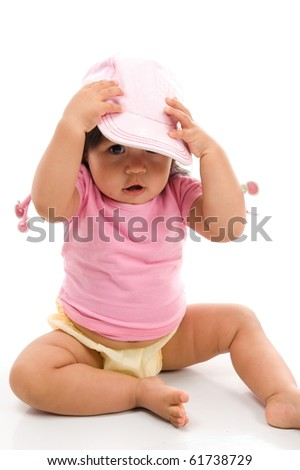 Cute Asian baby using a hat on white background .