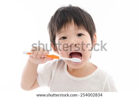 Cute asian bay brushing teeth on white background isolated - stock photo