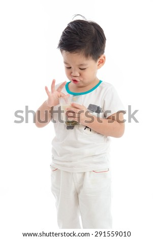 Cute asian boy drinking milk on white background isolated - stock photo