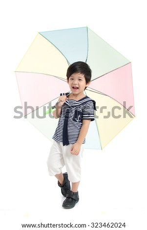 Cute asian boy in sailor uniform holding umbrella on white background isolated - stock photo