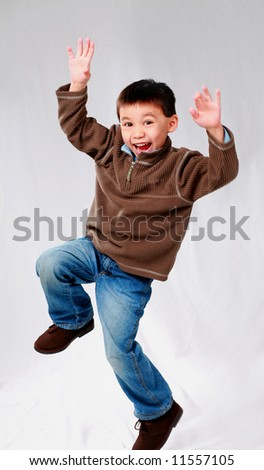 cute asian boy jumping in the air