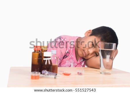 Cute asian boy sick with medicine