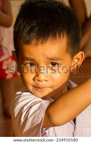 Cute asian boy with smiling face. - stock photo