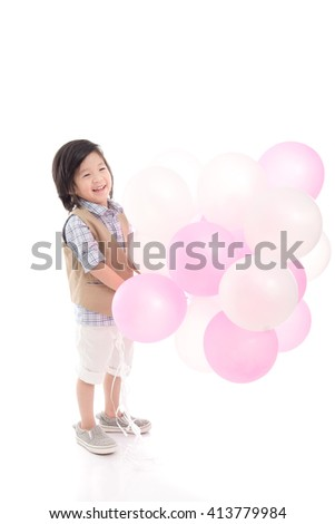 Cute Asian child holding pink and white balloons on white background isolated