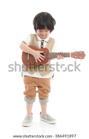 Cute asian child holding ukulele on white background isolated