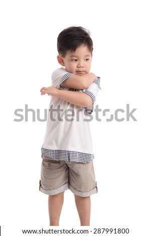 Cute asian child scratching on white background isolated  - stock photo
