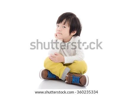 Cute asian child sitting on white background isolated - stock photo