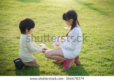 Cute asian children picking mushroom in the park