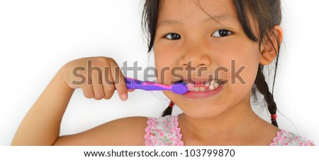 cute asian girl and toothbrush of thailand southeast asia - stock photo