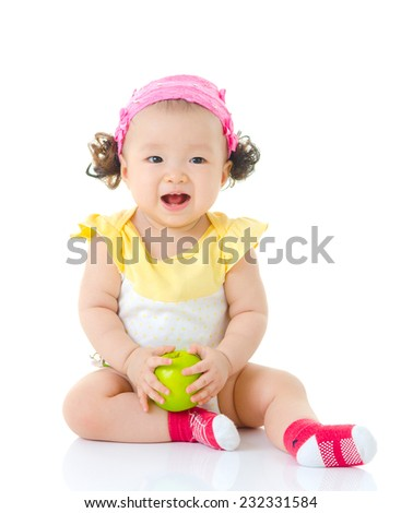 cute asian girl holding apple - stock photo