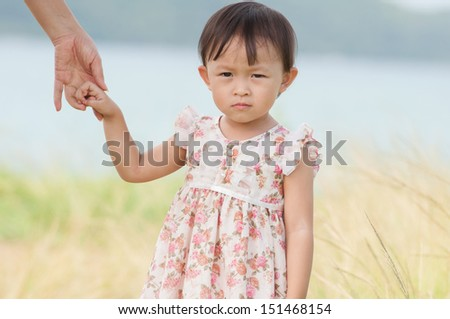 Cute asian girl  portrait in grass field.