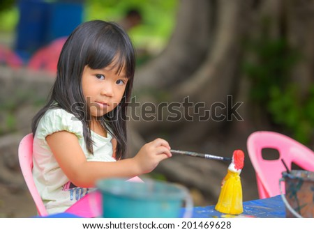 Cute Asian girl prefer to painting color - stock photo