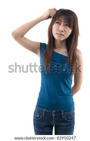Cute Asian girl thinking hard, scratching head and looking up on white background. - stock photo