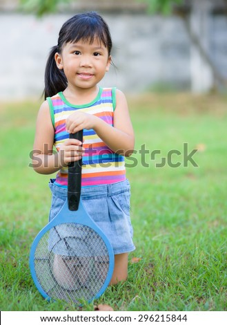 Cute asian holds electronic mosquito trap on nature background
