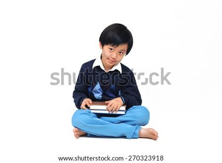 Cute Asian school boy model posing in casual wear - stock photo