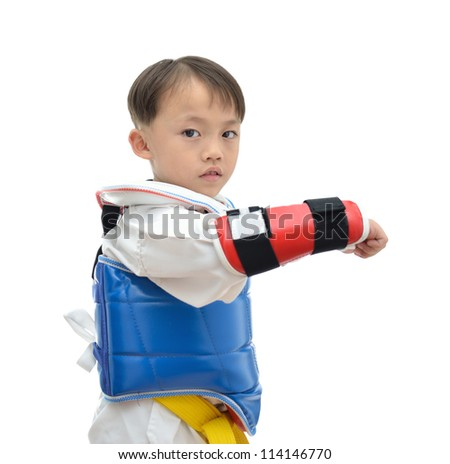 Cute asian taekwondo boy on white background. - stock photo