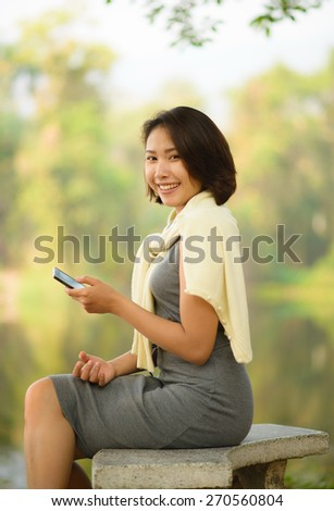 cute asian woman with cellphone - stock photo