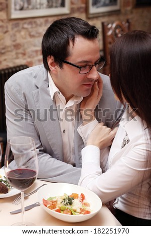 Cute, attractive couple in restaurant