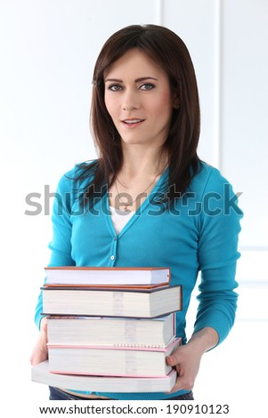 Cute, attractive woman holding books