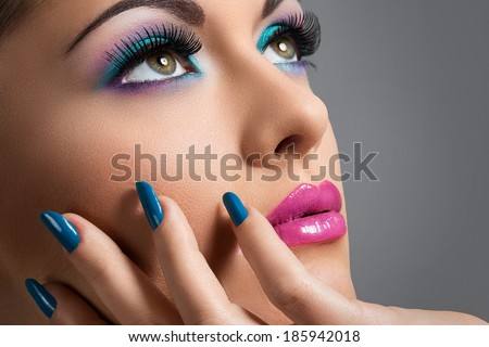 Cute, attractive woman with colorful makeup - stock photo