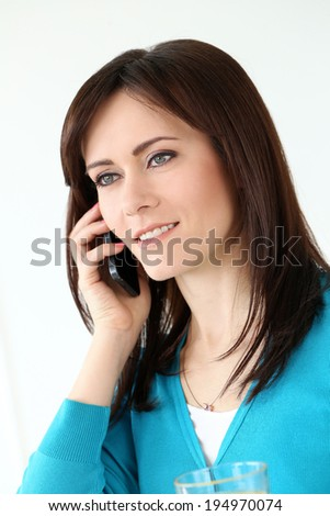 Cute, attractive woman with mobile phone