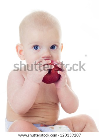 cute baby aeting red apple on white background