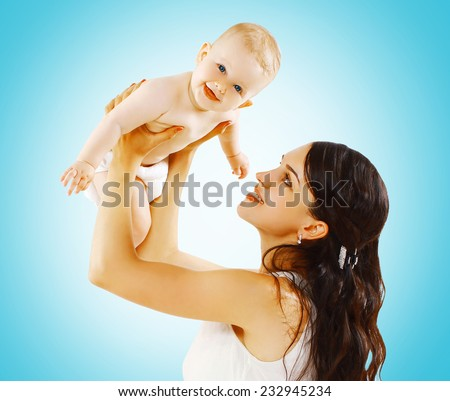 Cute baby and mother having fun - stock photo