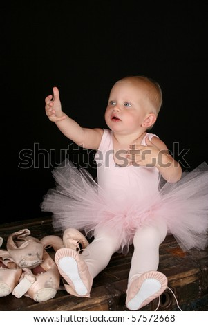 Cute baby ballerina wearing a pink leotard and tutu - stock photo