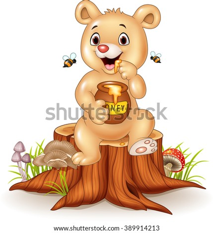 Cute baby bear holding honey pot on tree stump