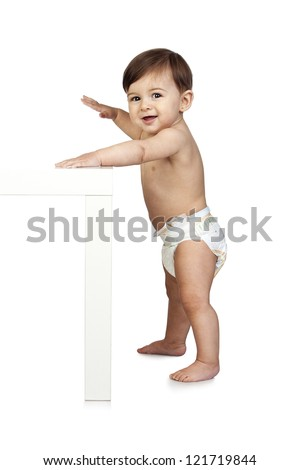Cute Baby Besides a Table Isolated on White - stock photo