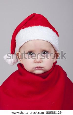 cute baby boy in Santa Claus Christmas outfit - stock photo