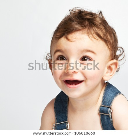 Cute baby boy isolated on white background, portrait of adorable sweet child, cheerful nice kid laughing indoor, pretty curious infant looking ahead, healthy lifestyle, happy childhood concept - stock photo