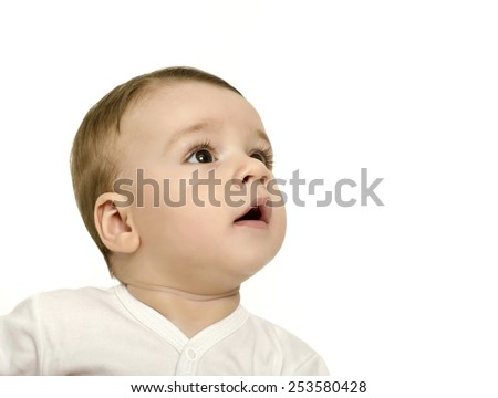 Cute baby boy looking up surprised. Baby in white looking curious. Isolated on white. - stock photo