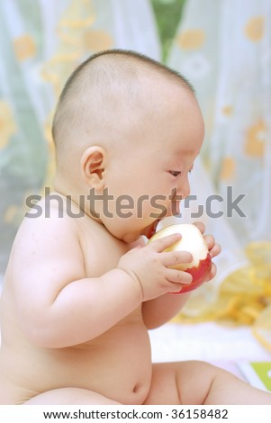 cute baby boy open his mouth to eat red apple - stock photo
