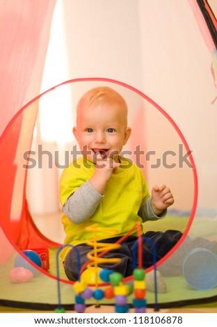 Cute baby boy playing - stock photo
