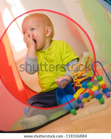 Cute baby boy playing at home - stock photo