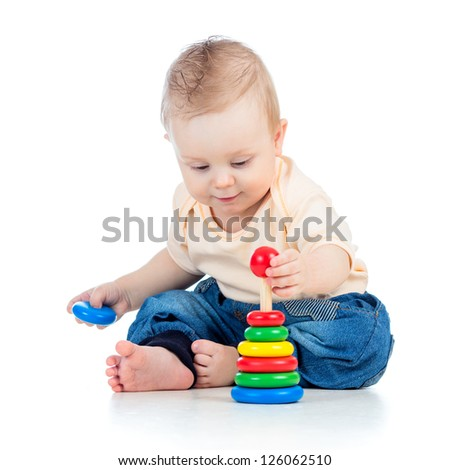 cute baby boy playing with colorful toy isolated on white