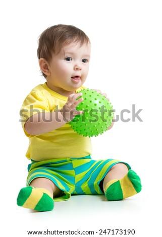 cute baby boy playing with massage ball - stock photo