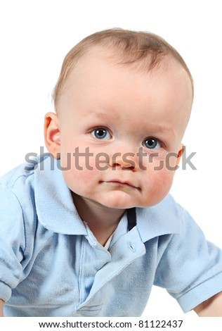 Cute baby boy posing for camera on white background