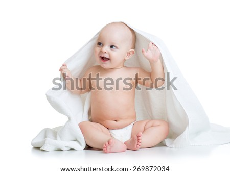 Cute baby boy under white towel after bath or shower - stock photo