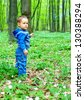cute baby boy walking in spring forest - stock photo