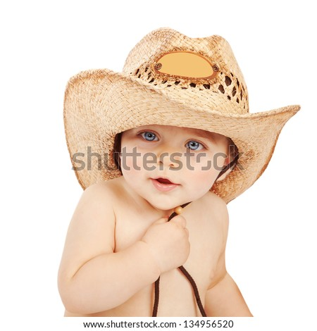 Cute baby boy wearing big cowboy hat isolated on white background, adorable child having fun indoors, happy childhood - stock photo