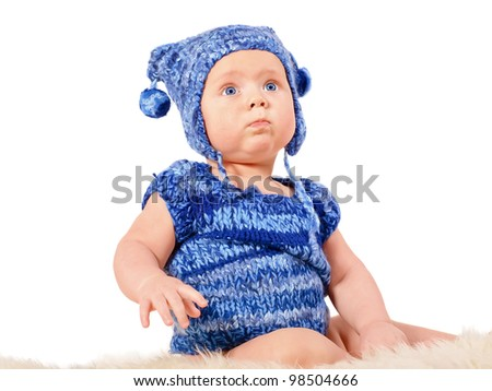 Cute baby boy wearing handmade blue costume with hat (isolated on white)