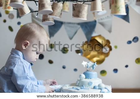 Cute baby boy with cake  celebrating birthday - stock photo